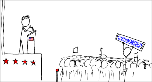 "A comic panel from the website XKCD showing a person speaking on a stage in front of a crowd, with one audience member standing up holding a sign that reads ""citation needed"" in the format used by Wikipedia."